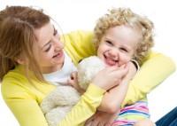 mother and kid girl having fun