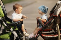 boy and girl in baby carriages