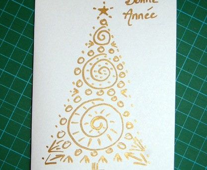 Auguri per le feste: un albero di Natale dorato