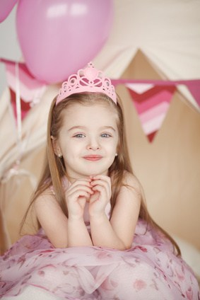 cute smiling little girl in pink princess