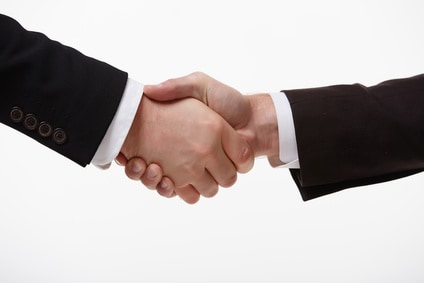 handshake of two businessmen fore