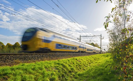 Passenger train moving at high speed in sunlight