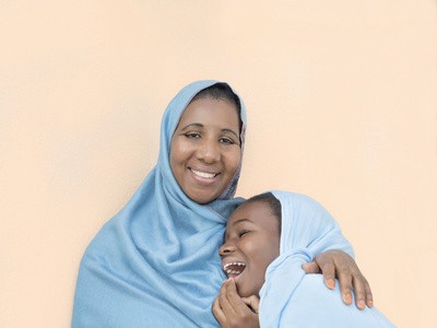 Mother and daughter smiling, maternal love and tenderness